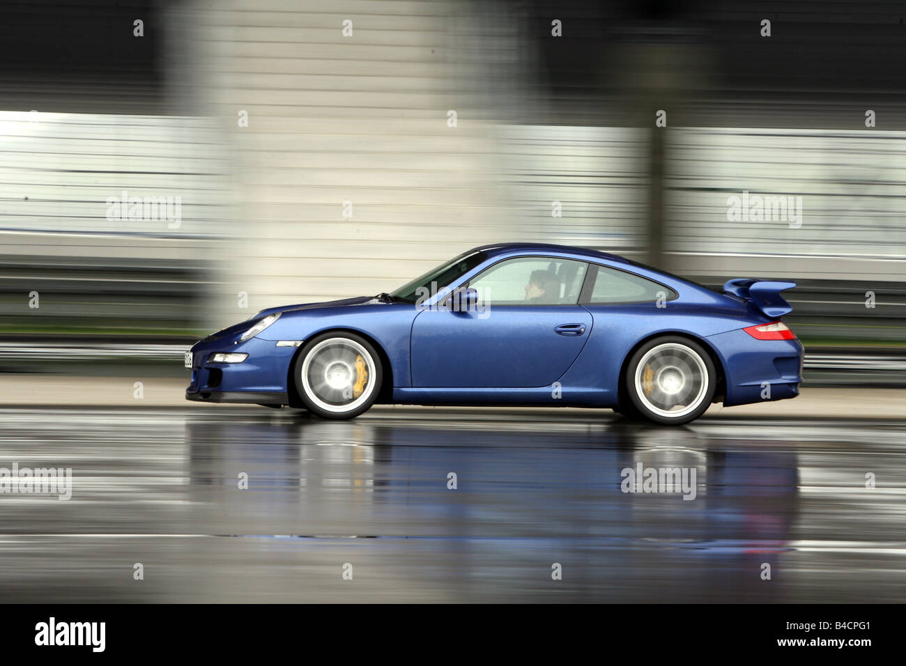 Porsche 911 GT3, model year 2006-, blue moving, side view, Test track - Stock Image