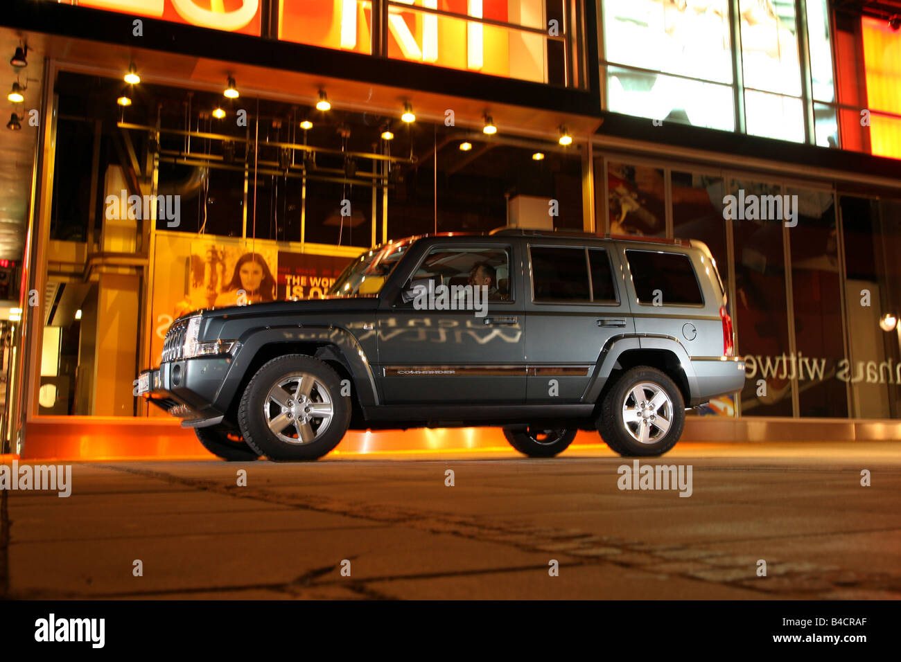 Jeep Commander 3.0 CRD, model year 2006-, silver, standing, upholding, side view, City, night shot, Evening - Stock Image