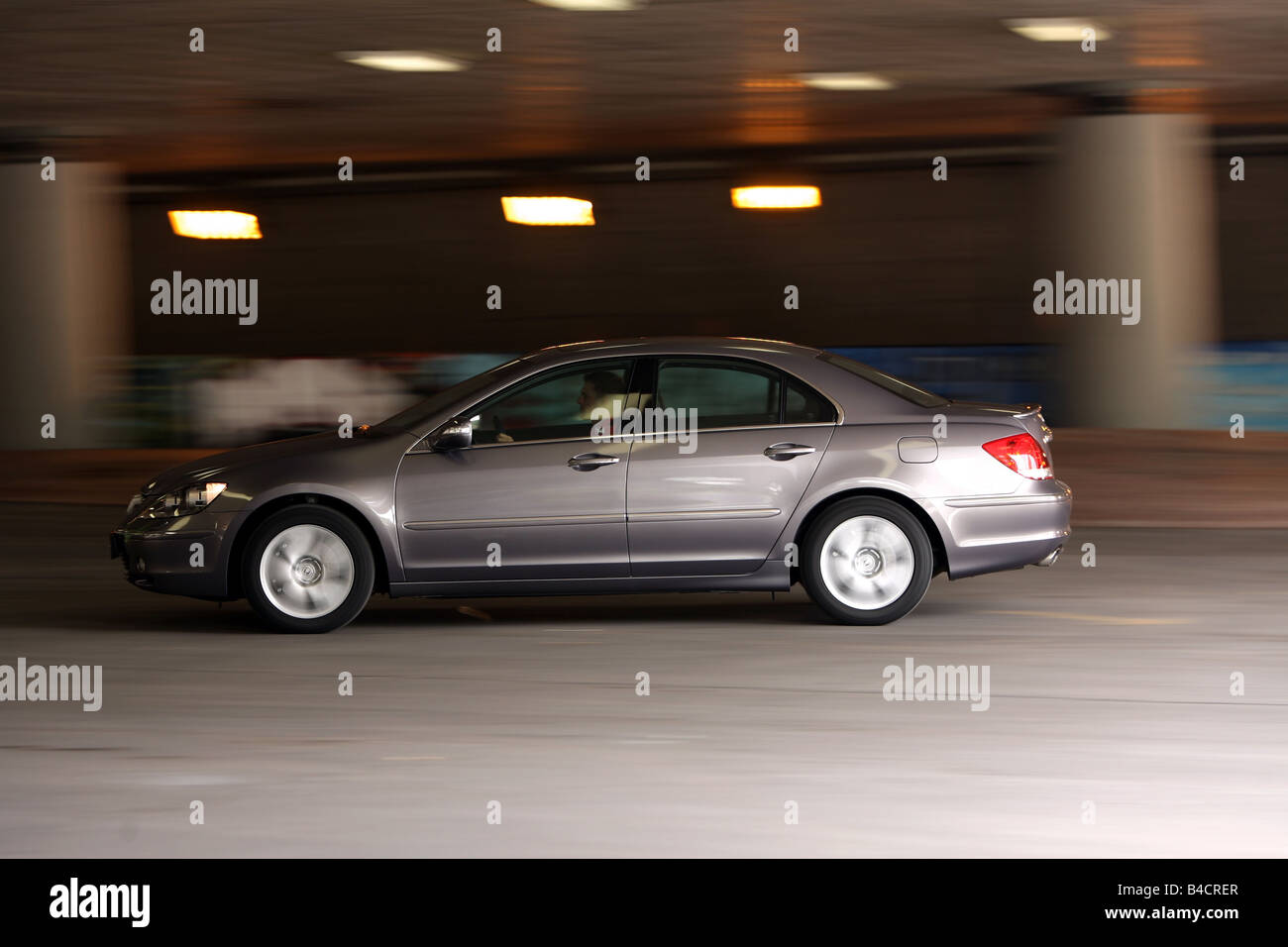 Honda Legend 3.5 SH-AWD, model year 2006-, anthracite, driving, side view, City - Stock Image
