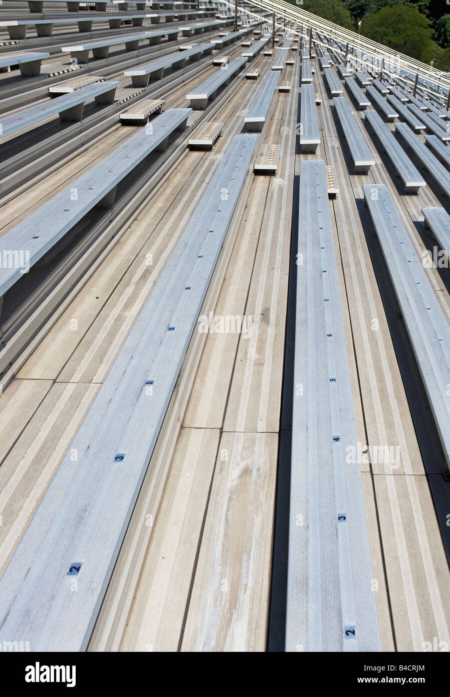 BLEACHER,, SPORTS,, STADIUM,, EMPTY,, EMPTINESS,, FURNITURE,, BENCHES,, ARCHITECTURE,, REPETITION,, SPORTS,, STADIUM,, - Stock Image