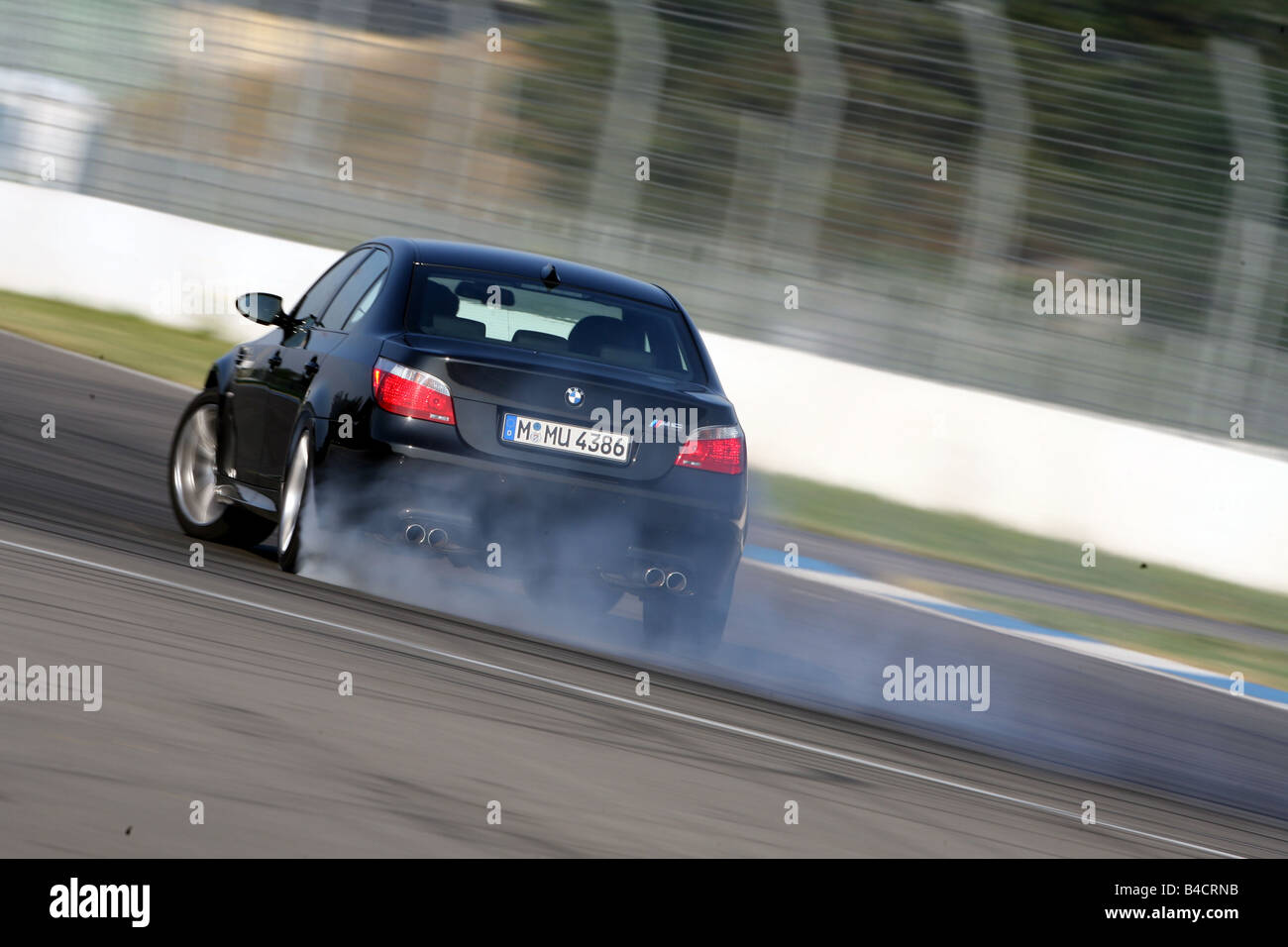 Bmw M5 Model Year 2005 Black Driving Diagonal From The Back Stock Photo Alamy