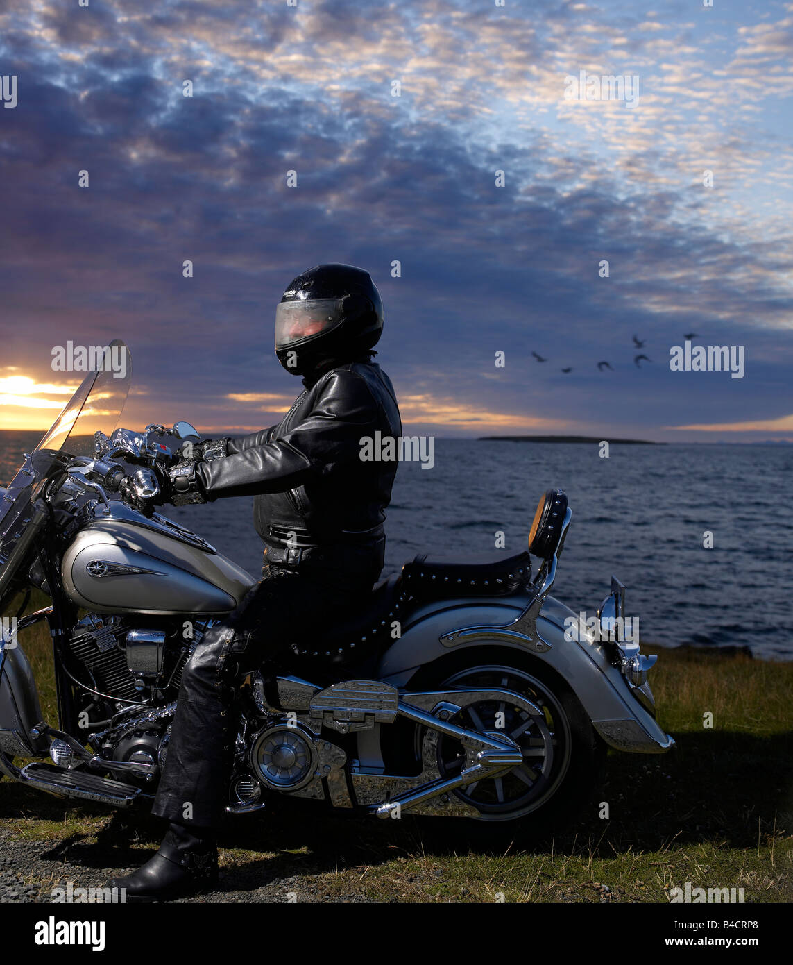 Motorcycle rider by the sea, Reykjavik Iceland - Stock Image