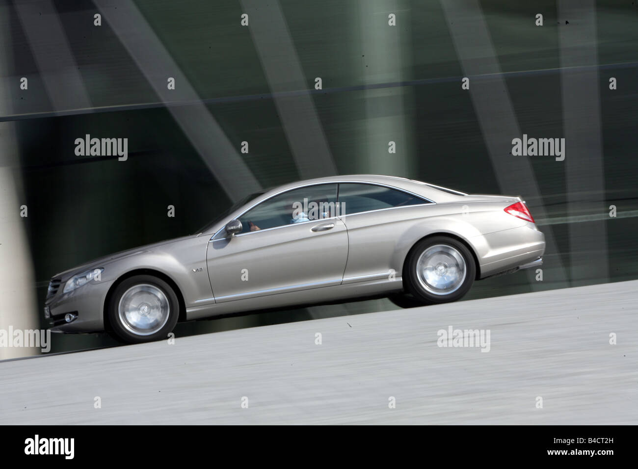 Mercedes CL 600, model year 2006-, silver, driving, side view, City - Stock Image