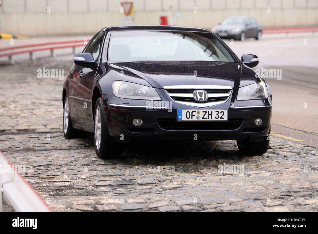 Honda Legend 3.5 V6 SH-AWD, model year 2006-, black, driving, diagonal from the front, frontal view, test track - Stock Image