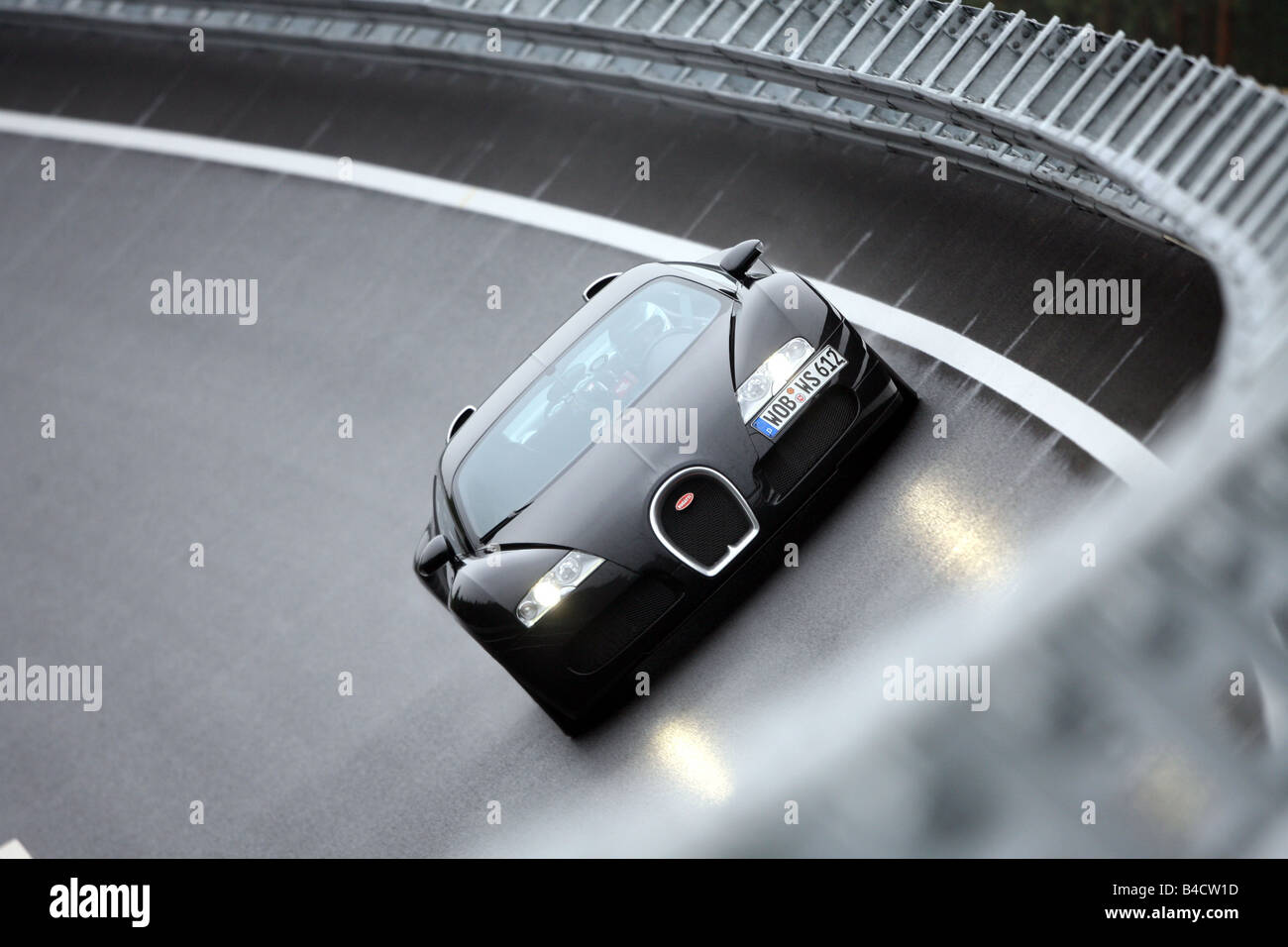 Bugatti 16.4 Veyron, model year 2006-, black, driving, diagonal from the front, frontal view, test track - Stock Image