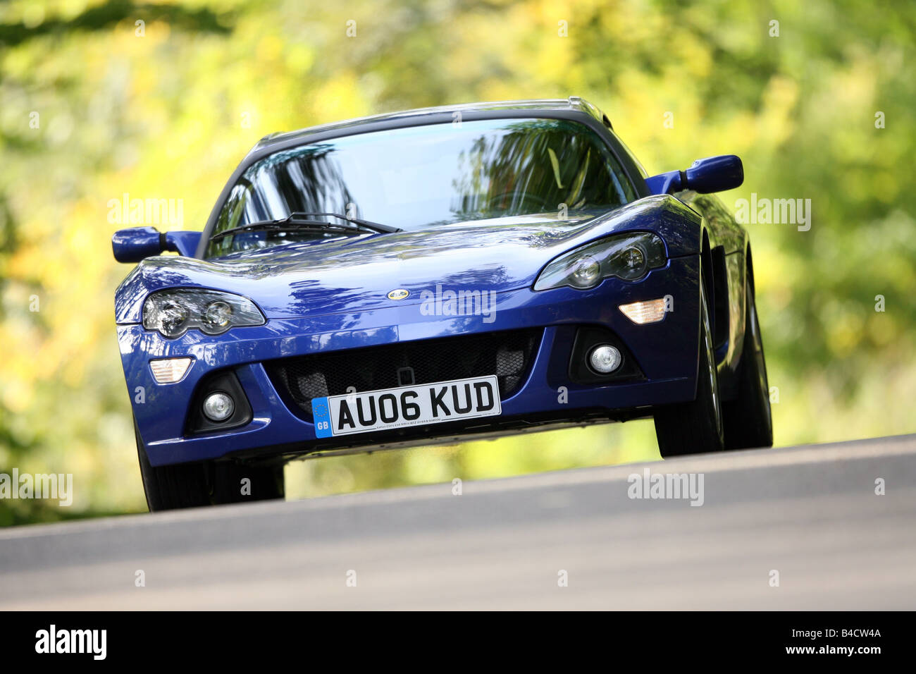 https://c8.alamy.com/comp/B4CW4A/lotus-europa-s-model-year-2006-blue-moving-diagonal-from-the-front-B4CW4A.jpg