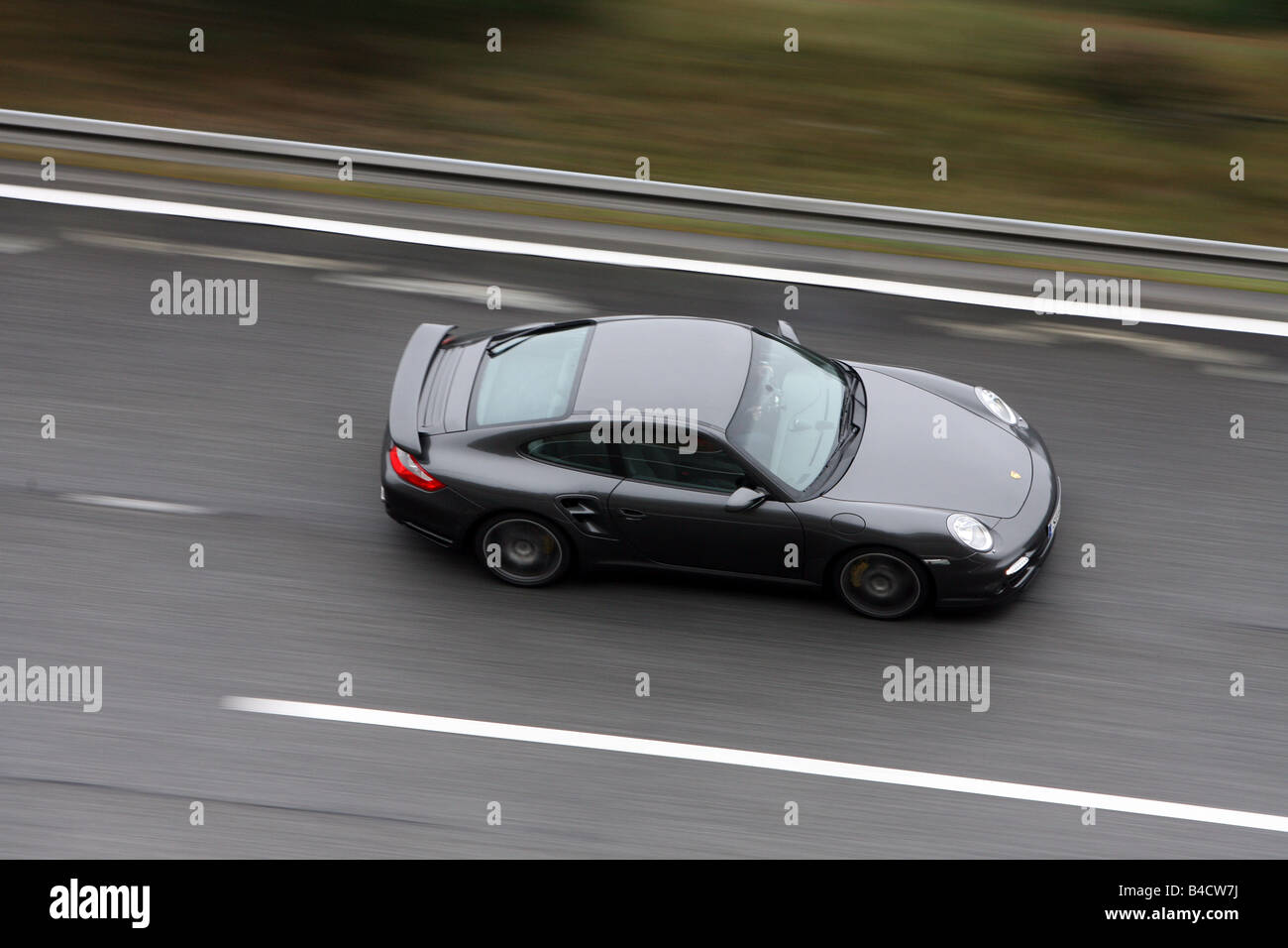 Porsche 911 Turbo, model year 2006-, black, driving, side view, test track - Stock Image