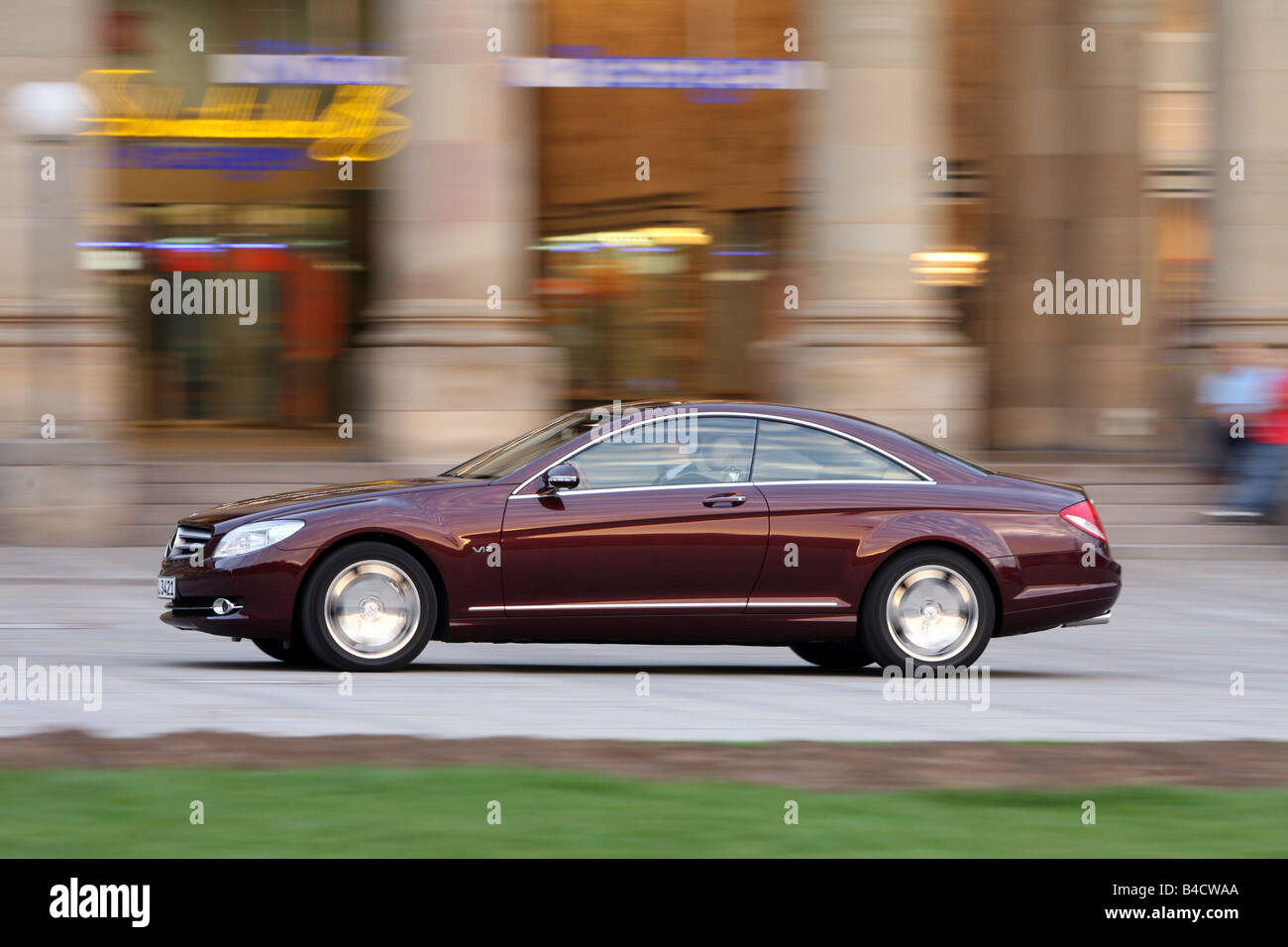 Mercedes CL 600, model year 2006-, ruby colored, driving, side view, City - Stock Image