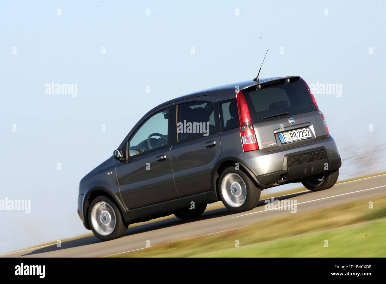 Fiat Panda 100 HP, model year 2006, anthracite, driving, diagonal from the back, rear view, country road - Stock Image