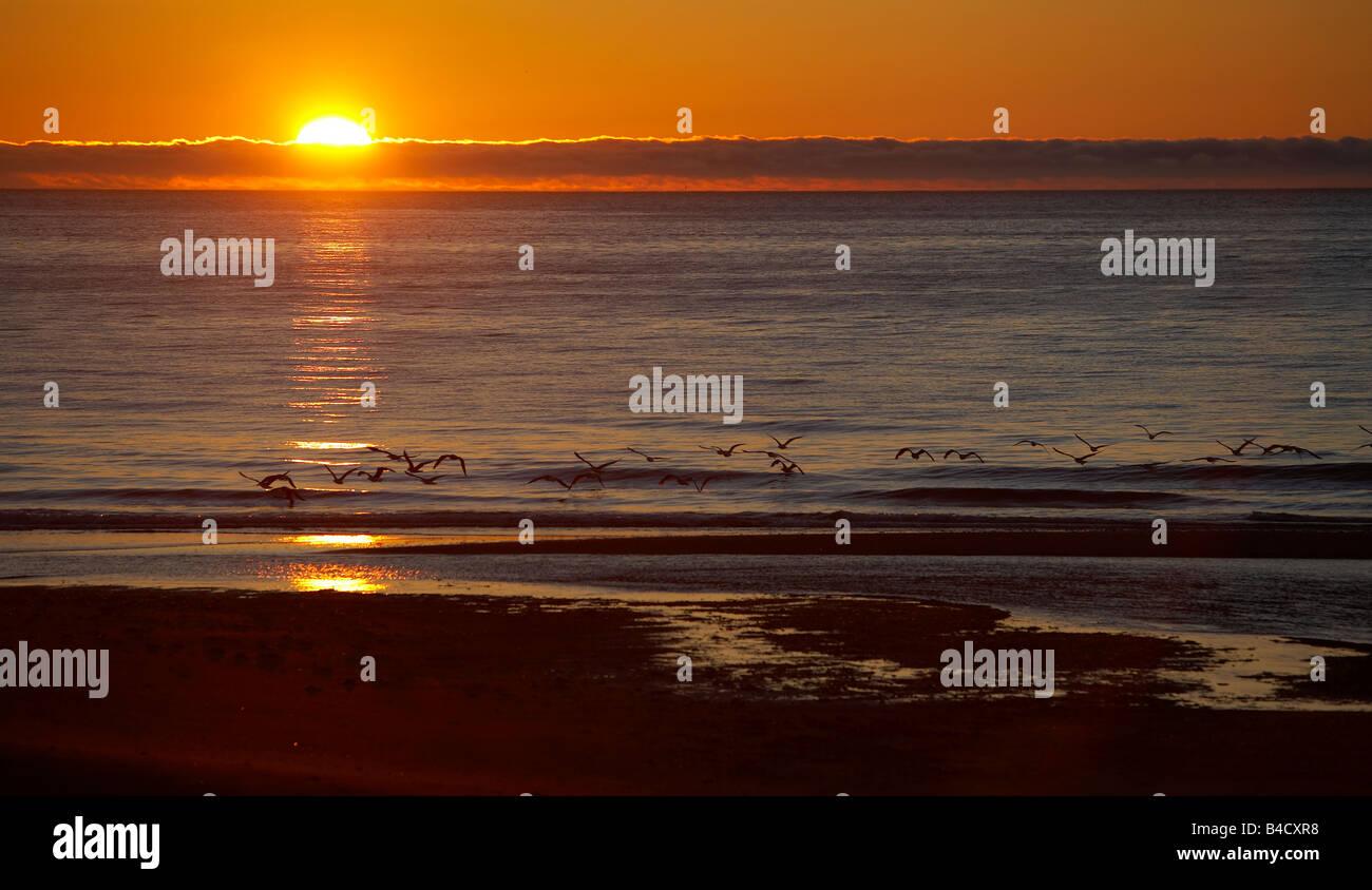 Midnight sun setting, Skalavik, West Fjords, Iceland - Stock Image