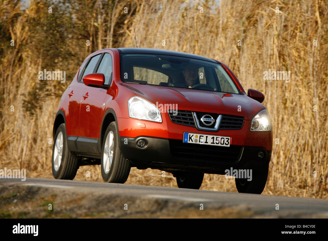Nissan Qashqai, model year 2007-, rust-red, driving, diagonal from ...