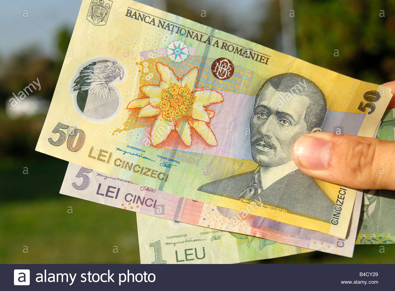 Romanian 1 leu and 5 and 50 lei notes. The 50 note depicts Aurel Vlaicu, Romanian engineer, inventor, pilot and - Stock Image