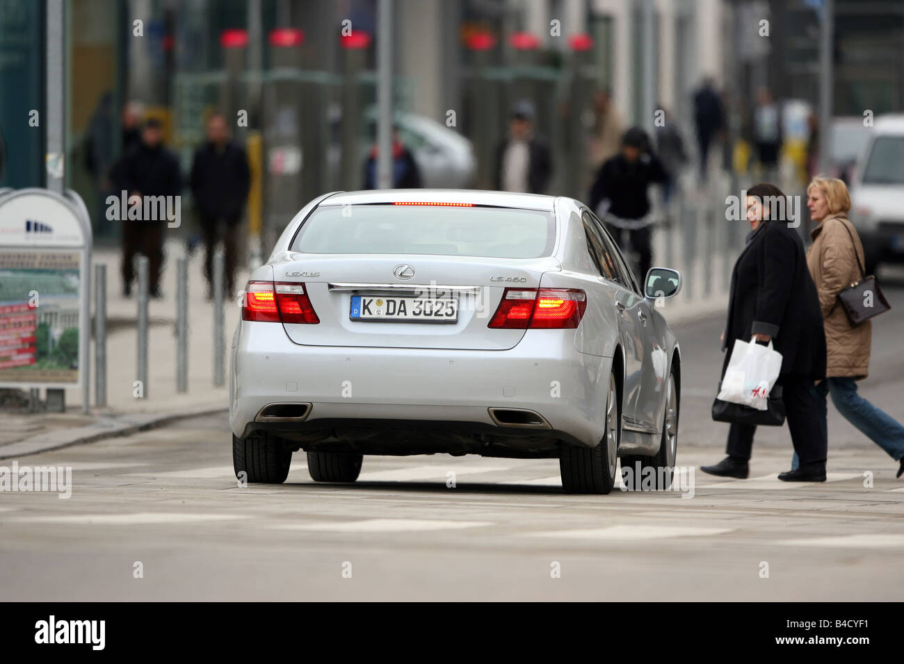 Lexus LS 460 Ambience Impression, model year 2007-, white, driving, diagonal from the back, rear view, City - Stock Image