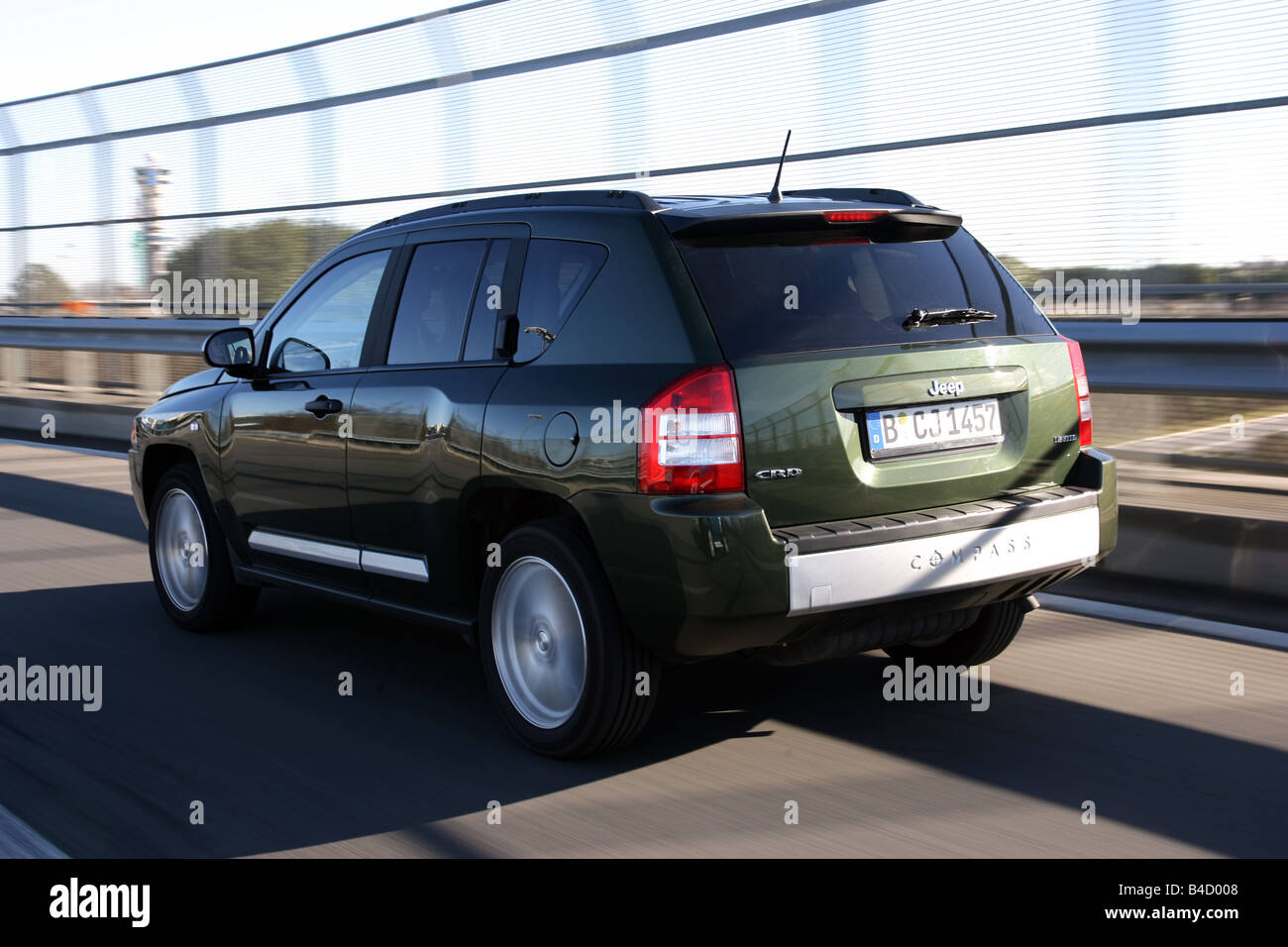 Jeep Compass 2.0 CRD Limited, model year 2007-, green, driving, diagonal from the back, rear view, country road - Stock Image