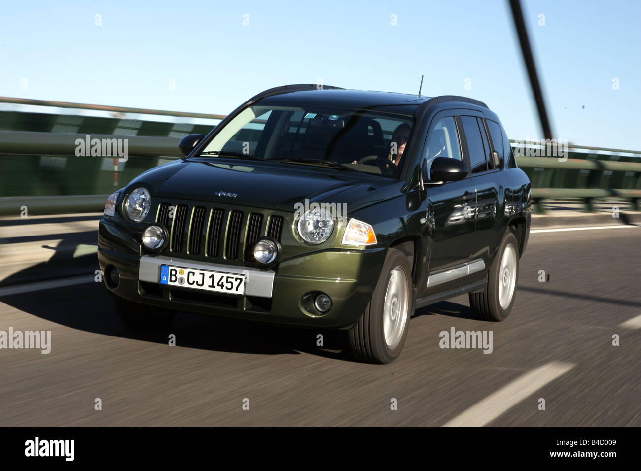 Jeep Compass 2.0 CRD Limited, model year 2007-, green, driving, diagonal from the front, frontal view, country road - Stock Image