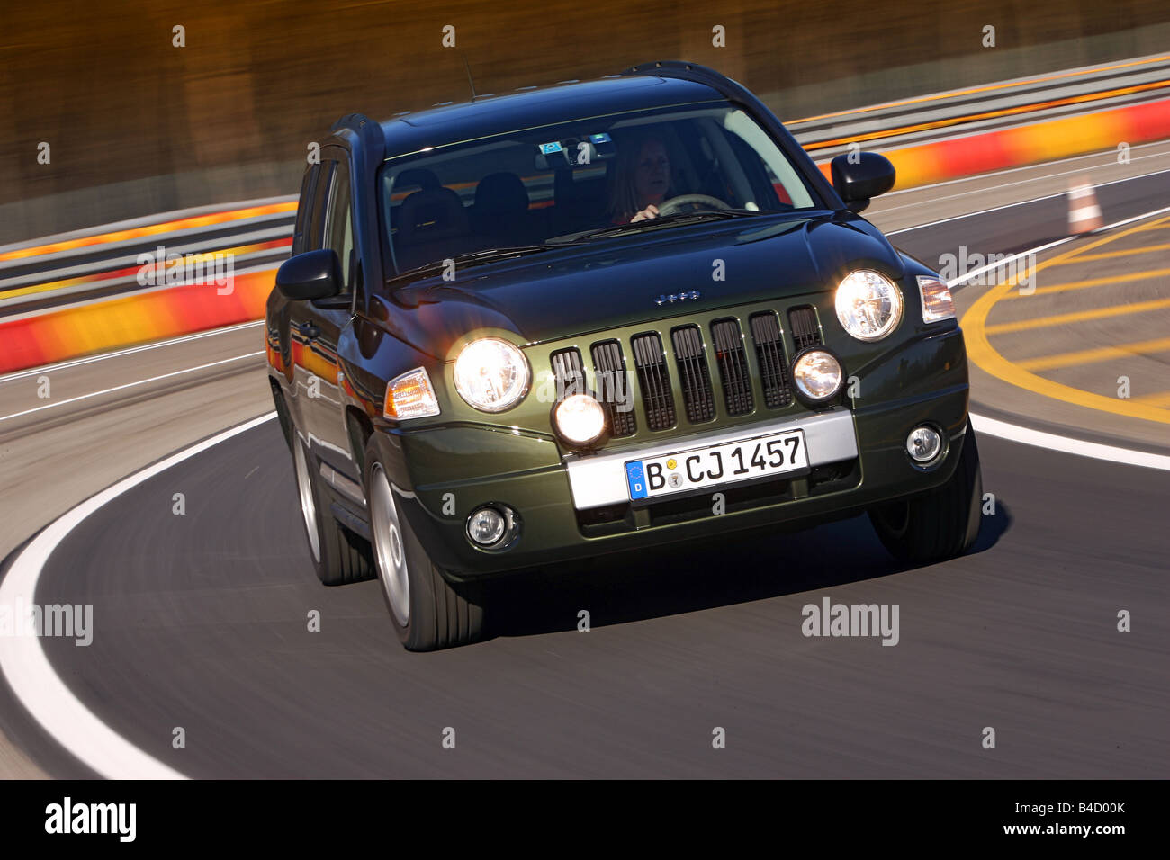 Jeep Compass 2.0 CRD Limited, model year 2007-, green, driving, diagonal from the front, frontal view, test track - Stock Image
