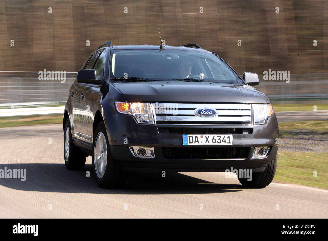 Ford Suv Edge Model Year  Anthracite Driving Diagonal From The Front Frontal View Test Track