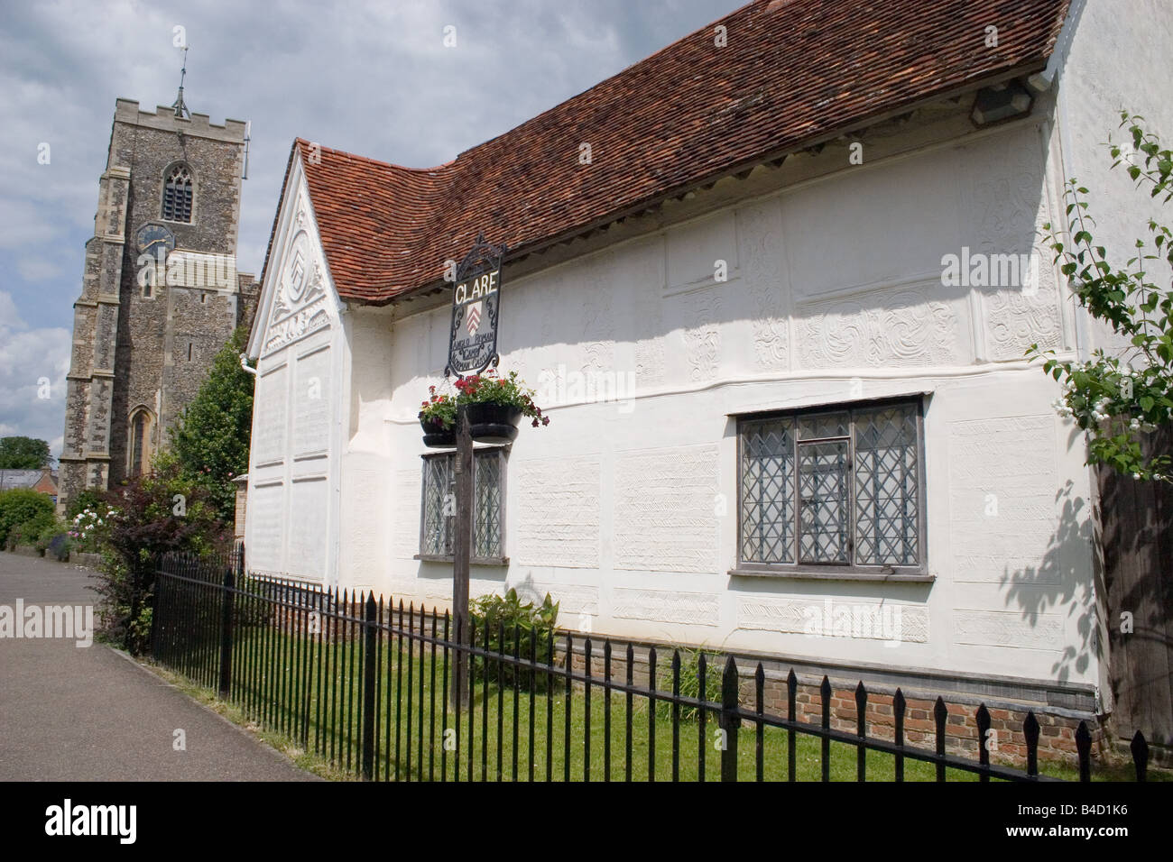 The Ancient House and St Peter and Paul Church medieval town of Clare Suffolk England - Stock Image