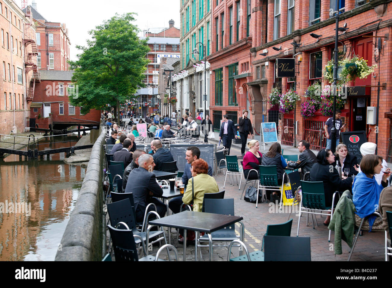 July 2008 - People sitting at outdoors cafes on Canal street known also as the Gay village Manchester England UK - Stock Image