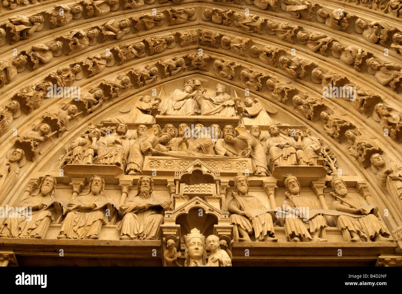 reliefs at the entrance gate to Notre Dame de Paris in Paris France - Stock Image