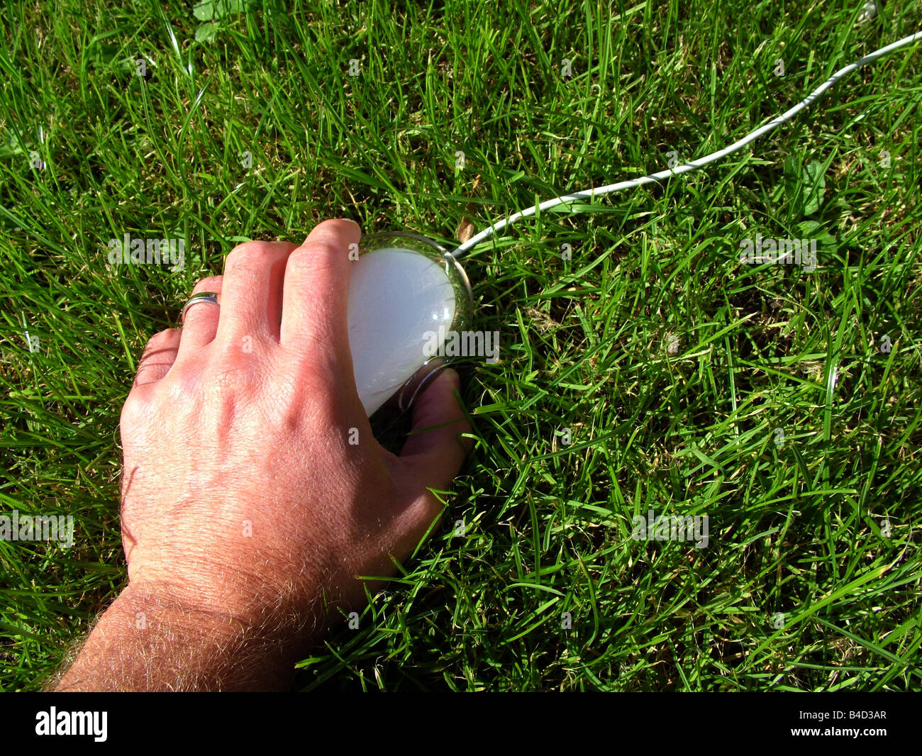 Hand holding computer mouse Stock Photo
