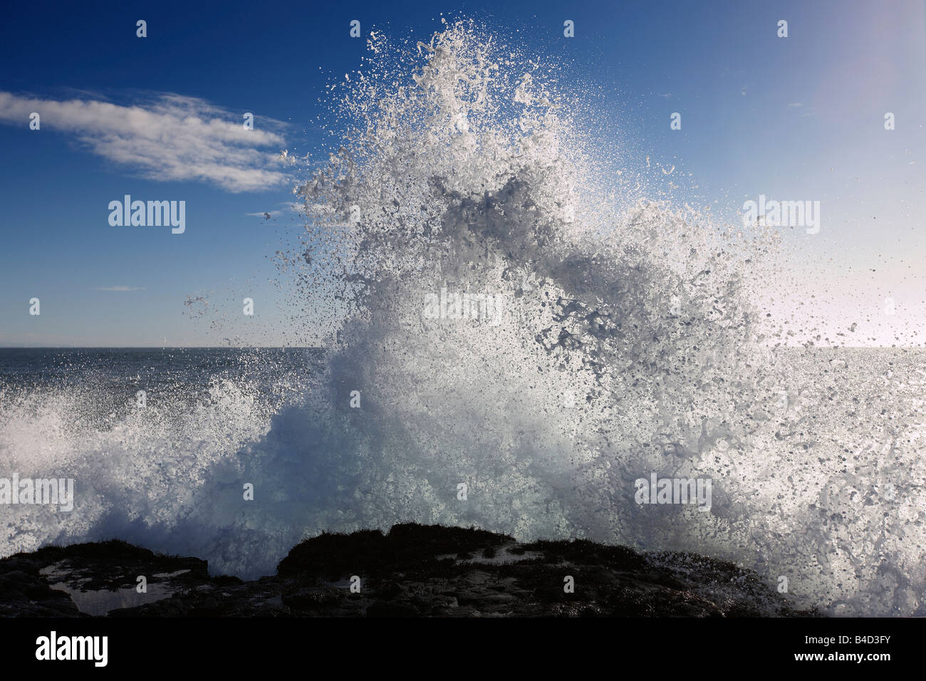 Waves breaking over rocks, South Coast Icleand Stock Photo