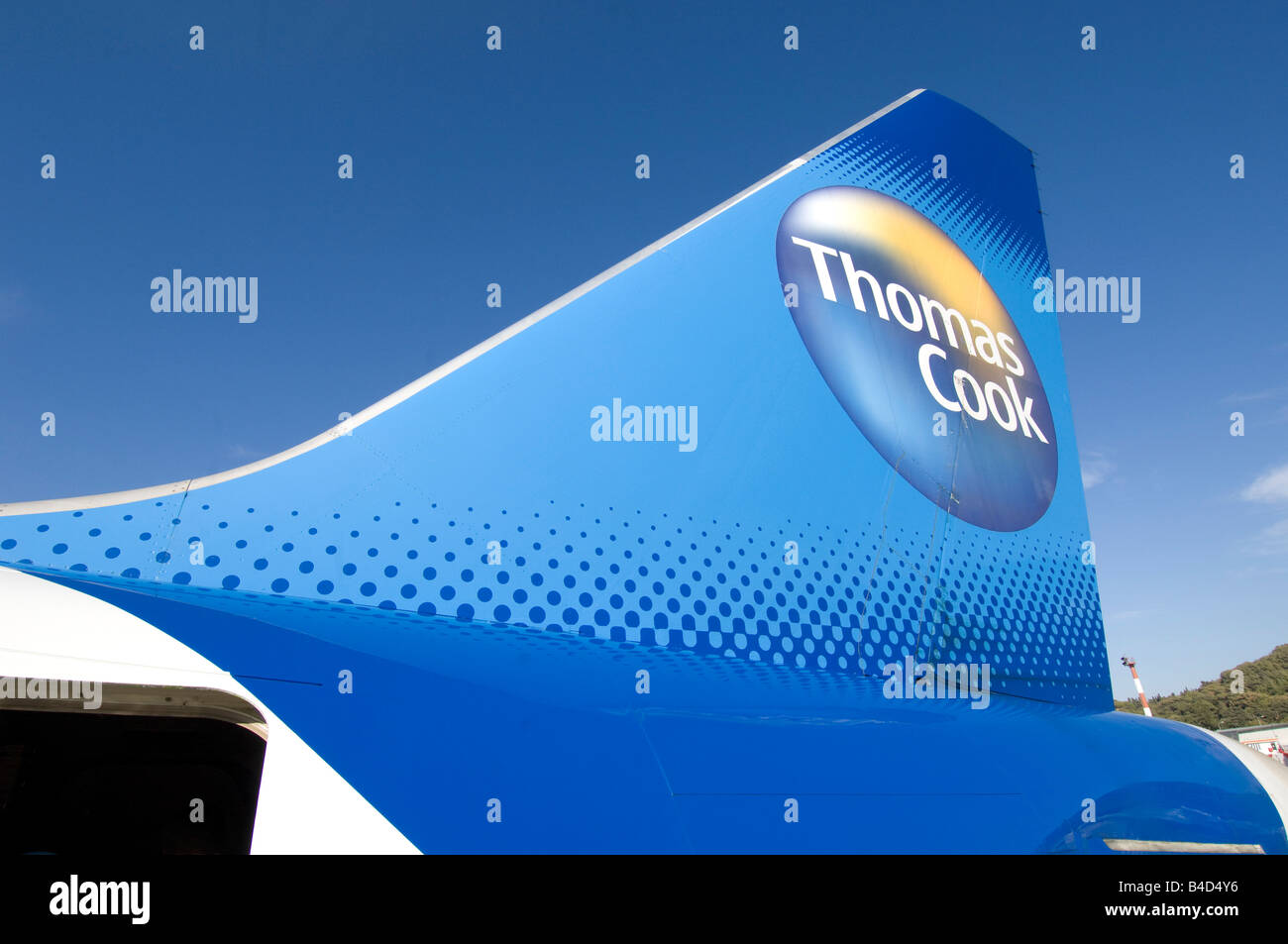 The tail plane of a Thomas Cook Boeing 757 200 holiday jet airliner at Rhodes airport Greece - Stock Image