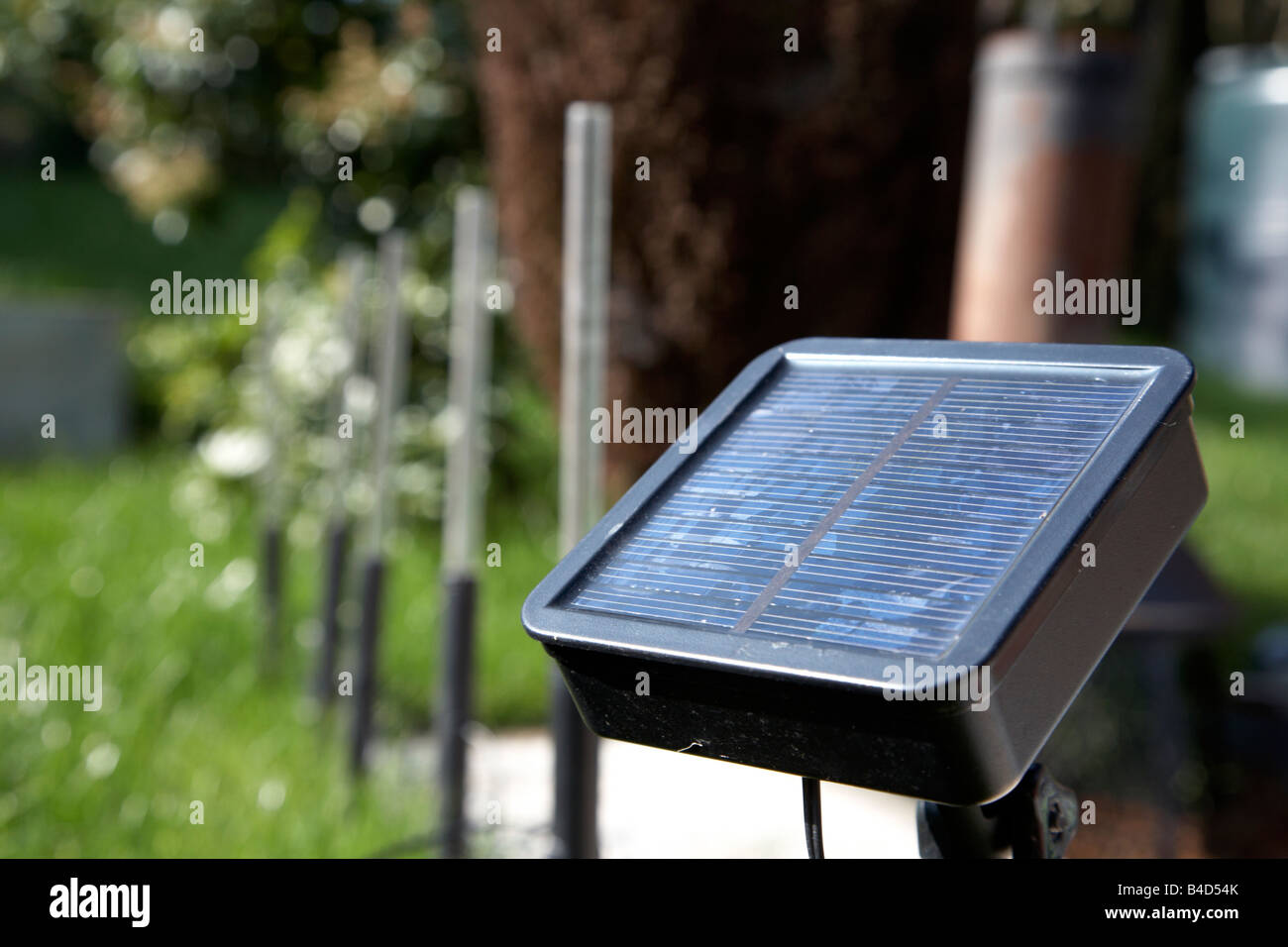 solar garden lighting being used to light pathway in garden in the uk - Stock Image