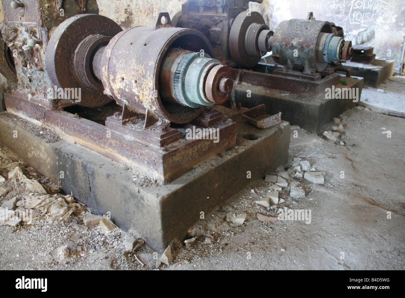 old damaged machinery in derelict manufacturing workshop