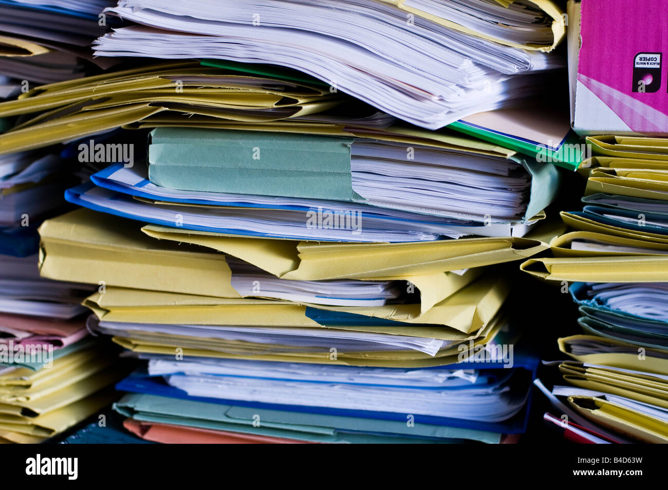 Piles of folders containing paper documents - Stock Image
