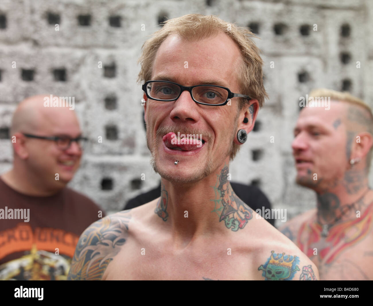 Tattooed Man Showing Split Tongue, Reykjavik Iceland - Stock Image