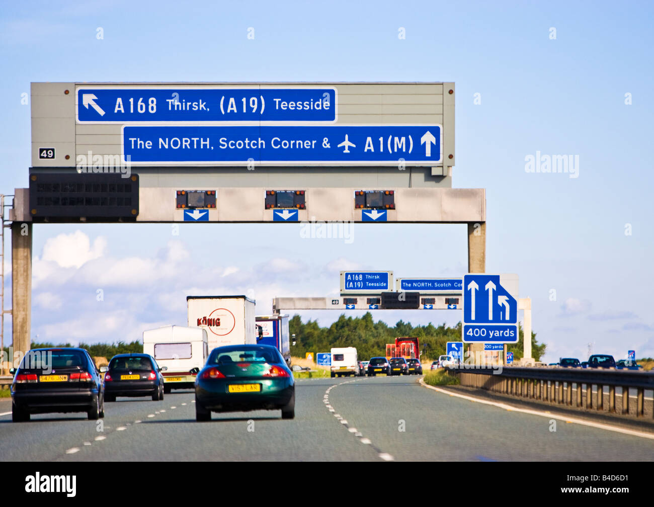 Driving on a motorway uk, the A1M / A1 a UK motorway with motorway sign in England, UK - Stock Image