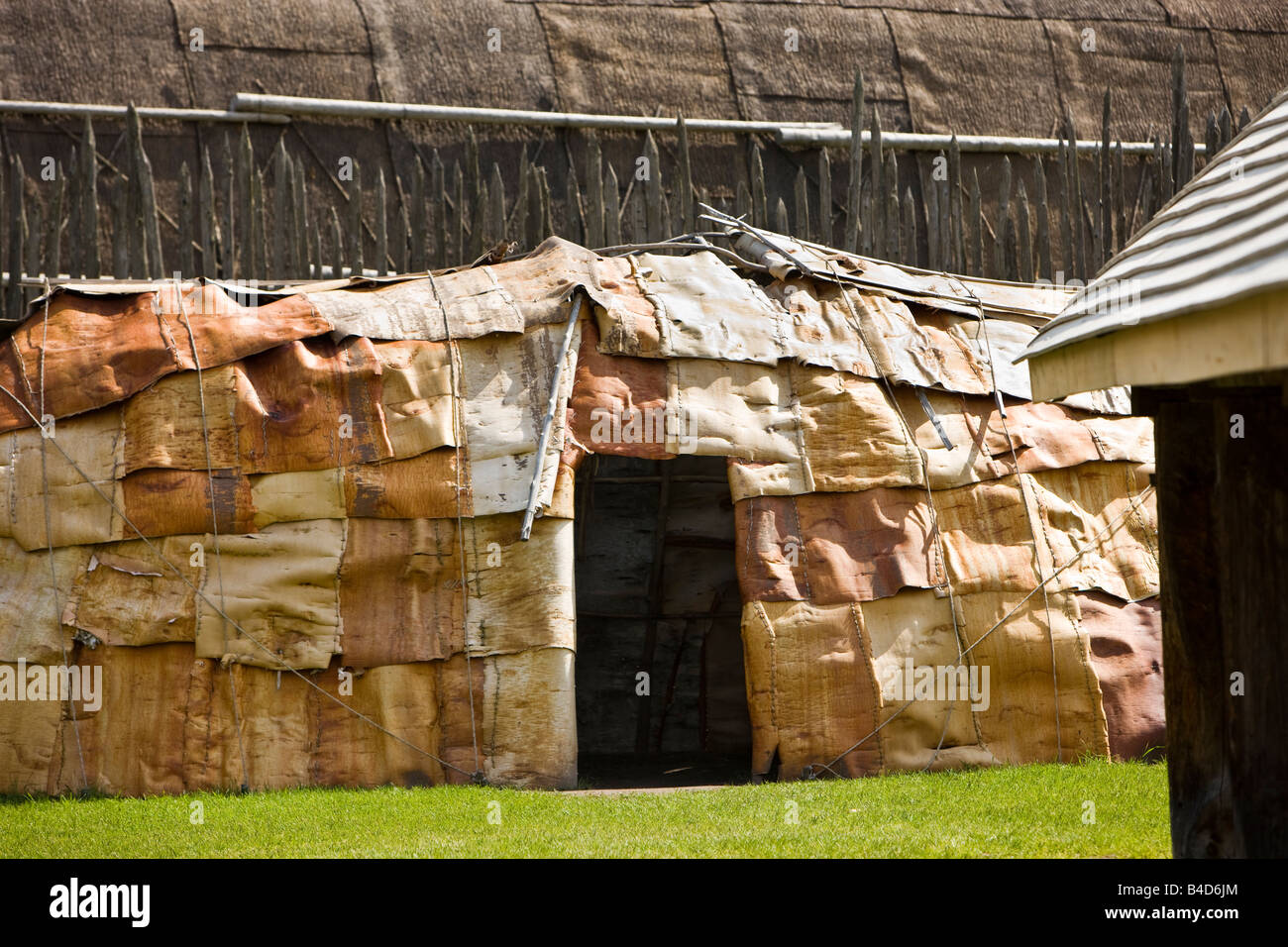 Animal skins on the exterior of a building in the Native Area of the Sainte-Marie among the Hurons complex in town - Stock Image