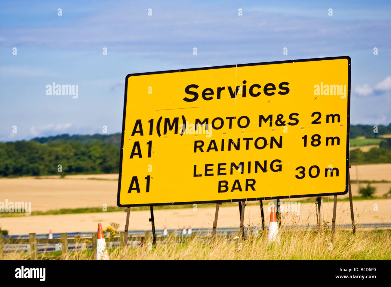 Yellow sign on A road roadworks showing revised mileages to nearest service stations England UK - Stock Image