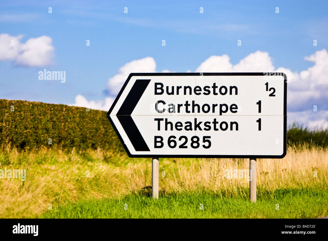 B road sign non-primary route traffic UK road sign with number and distance information England - Stock Image