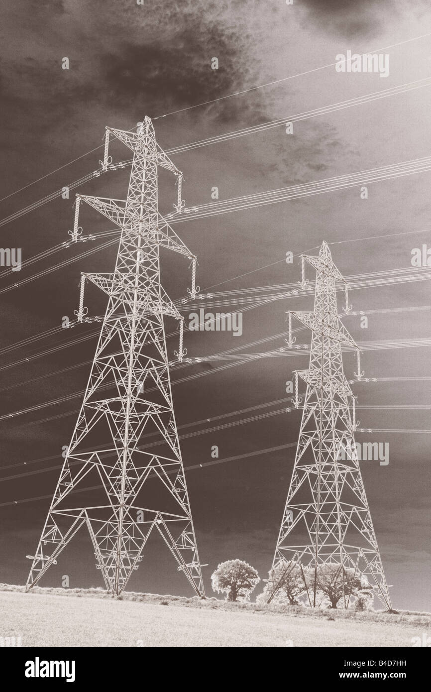 low angle black and white view of pylons and cables Sufolk - Stock Image