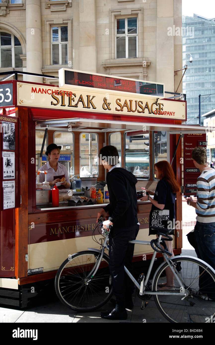 Aug 2008 - Food stall selling traditional steak and sausage Manchester England UK - Stock Image