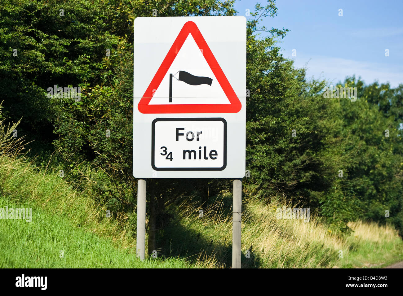 Road sign warning sign of side winds with wind sock and expected distance in England, UK - Stock Image