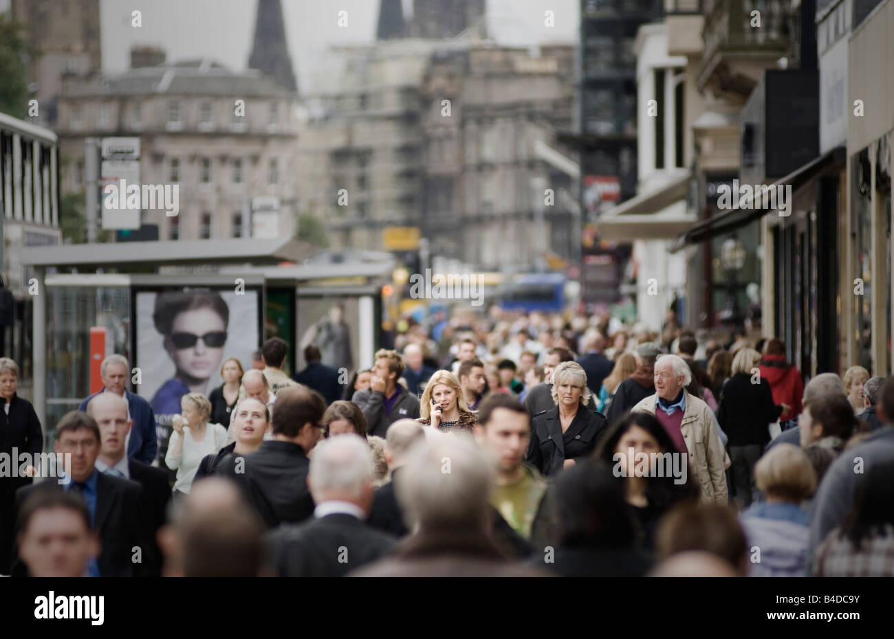 Edinburgh's Princes Street on a busy day with many people out shopping - Stock Image