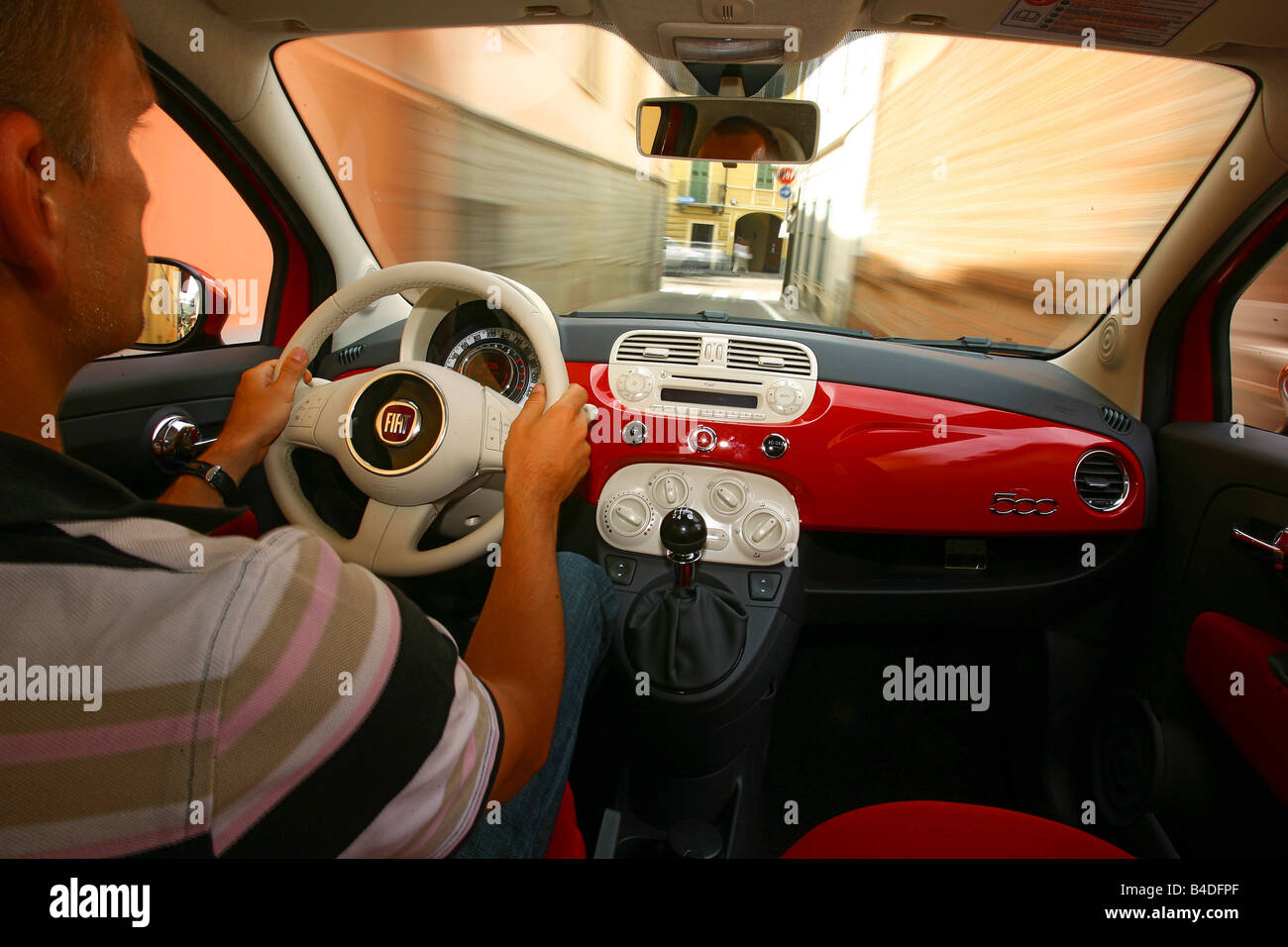 https://c8.alamy.com/comp/B4DFPF/fiat-500-model-year-2007-red-driving-interior-view-panned-shot-from-B4DFPF.jpg
