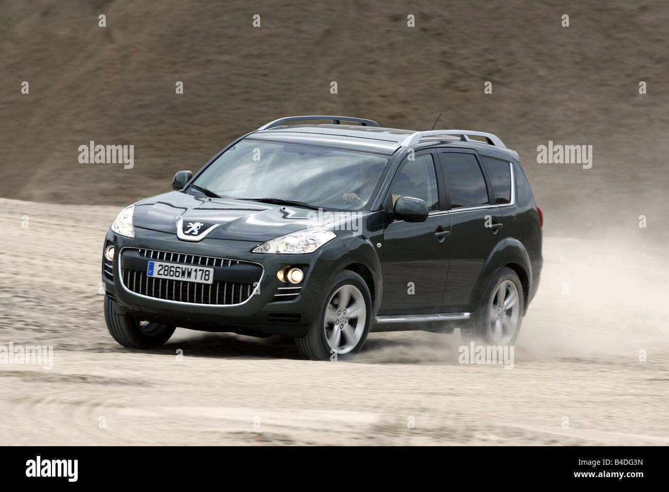 Peugeot 4007 HDi FAP 155 Platinum, model year 2007-, anthracite, driving, diagonal from the front, frontal view, - Stock Image