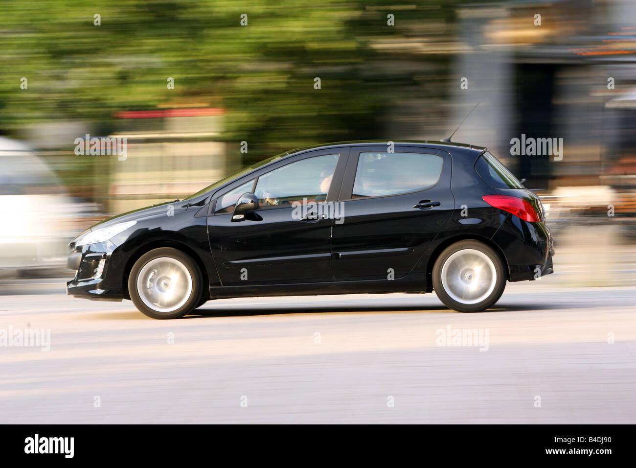 Peugeot 308 HDi FAP 135 Sport Plus, model year 2007-, black, driving, side view, City - Stock Image