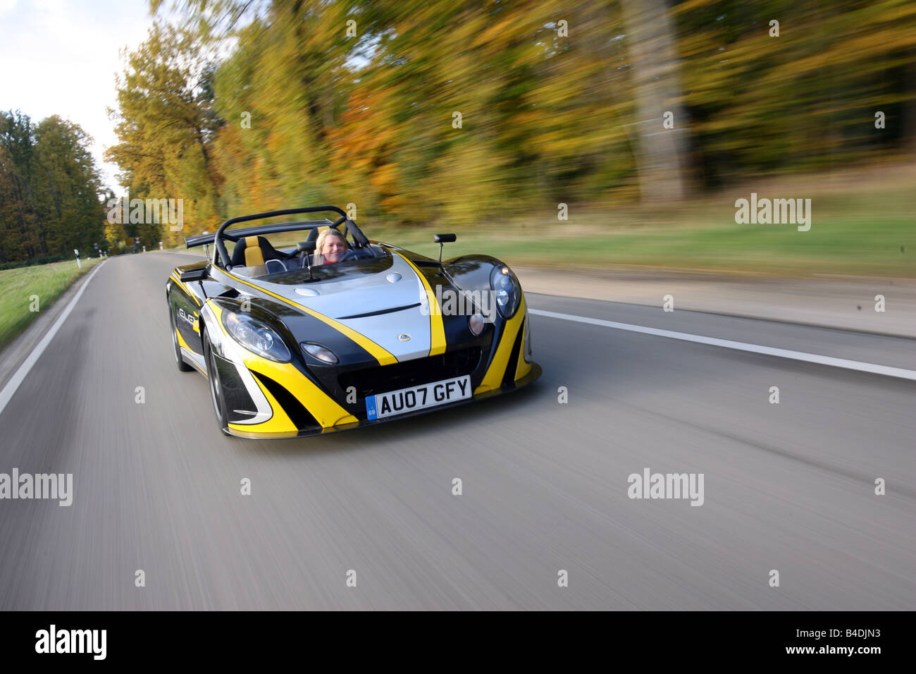 Lotus 2-Eleven, model year 2007-, black-yellow, driving, moving, diagonal from the front, frontal view, road - Stock Image