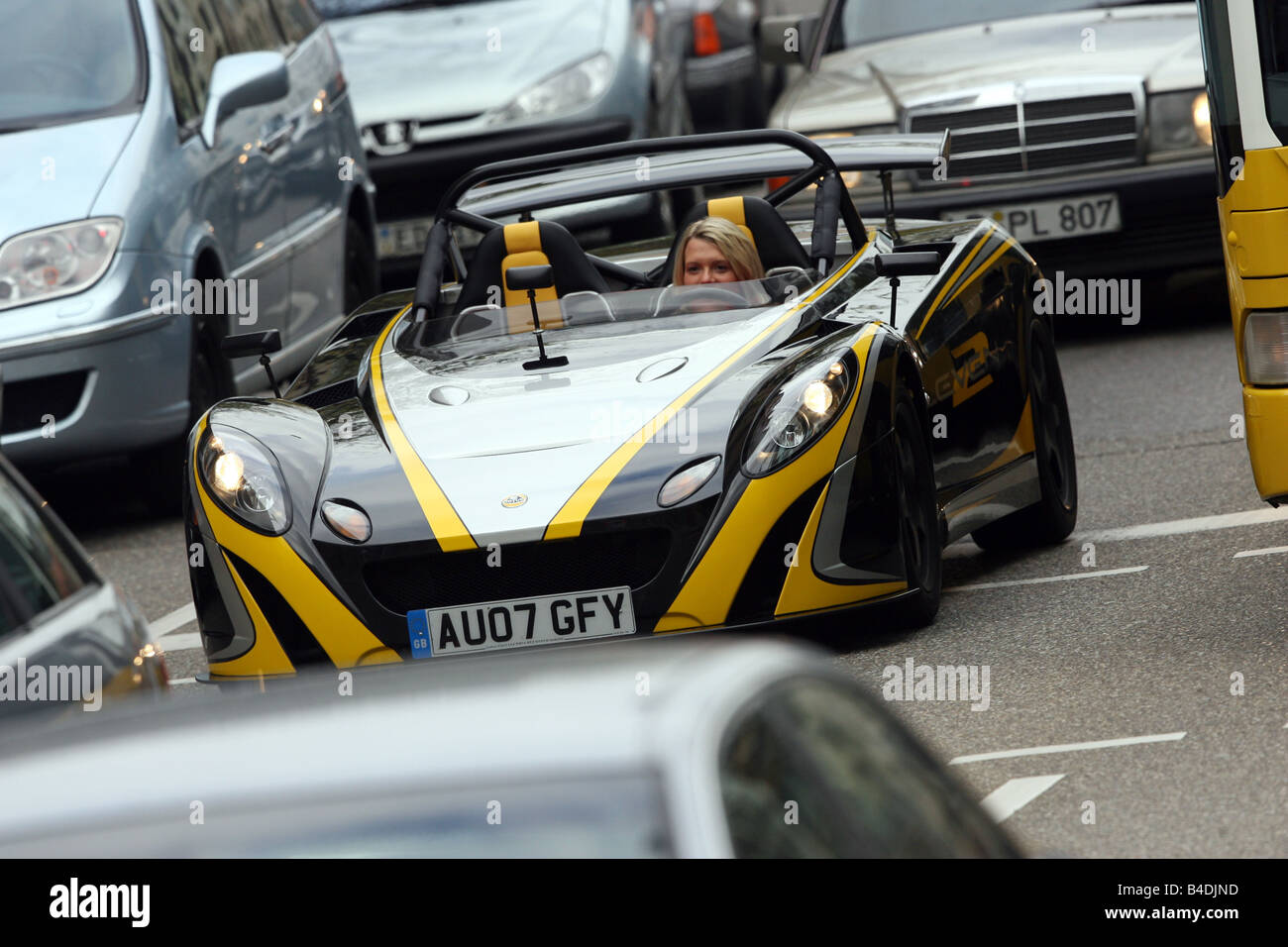 Lotus 2-Eleven, model year 2007-, black-yellow, driving, standing, upholding, diagonal from the front, frontal view, - Stock Image