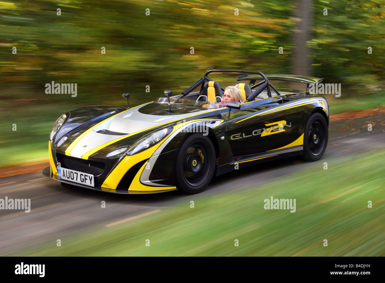 Lotus 2-Eleven, model year 2007-, black-yellow, driving, moving ...