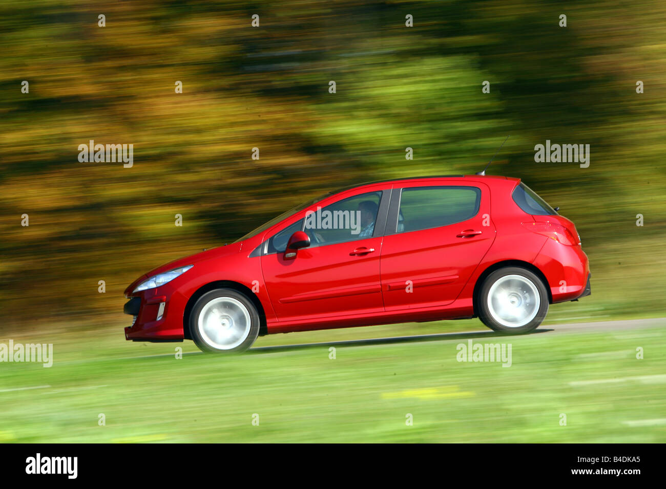 Peugeot 308 150 THP Sport Plus, model year 2007-, red, driving, side view, country road Stock Photo