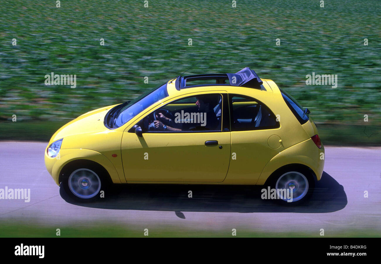 Car Ford Ka  I Small Approx Limousine Model Year   Yellow Driving Diagonal From The Front Oben Side View Cou
