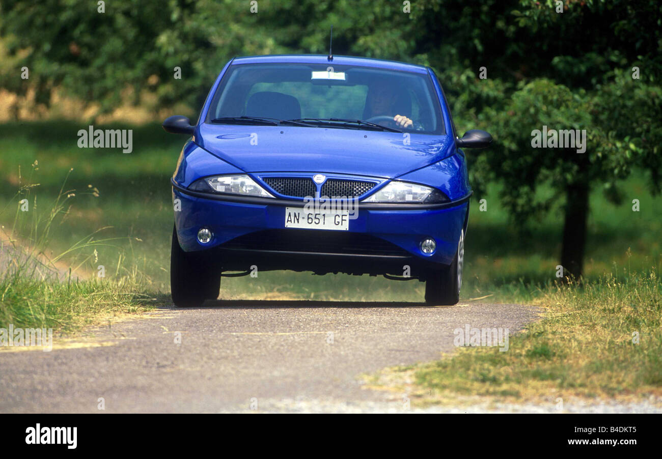 Car, Lancia Y Elefantino, small approx., blue, model year 1995-2001, frontal view, driving, country road - Stock Image