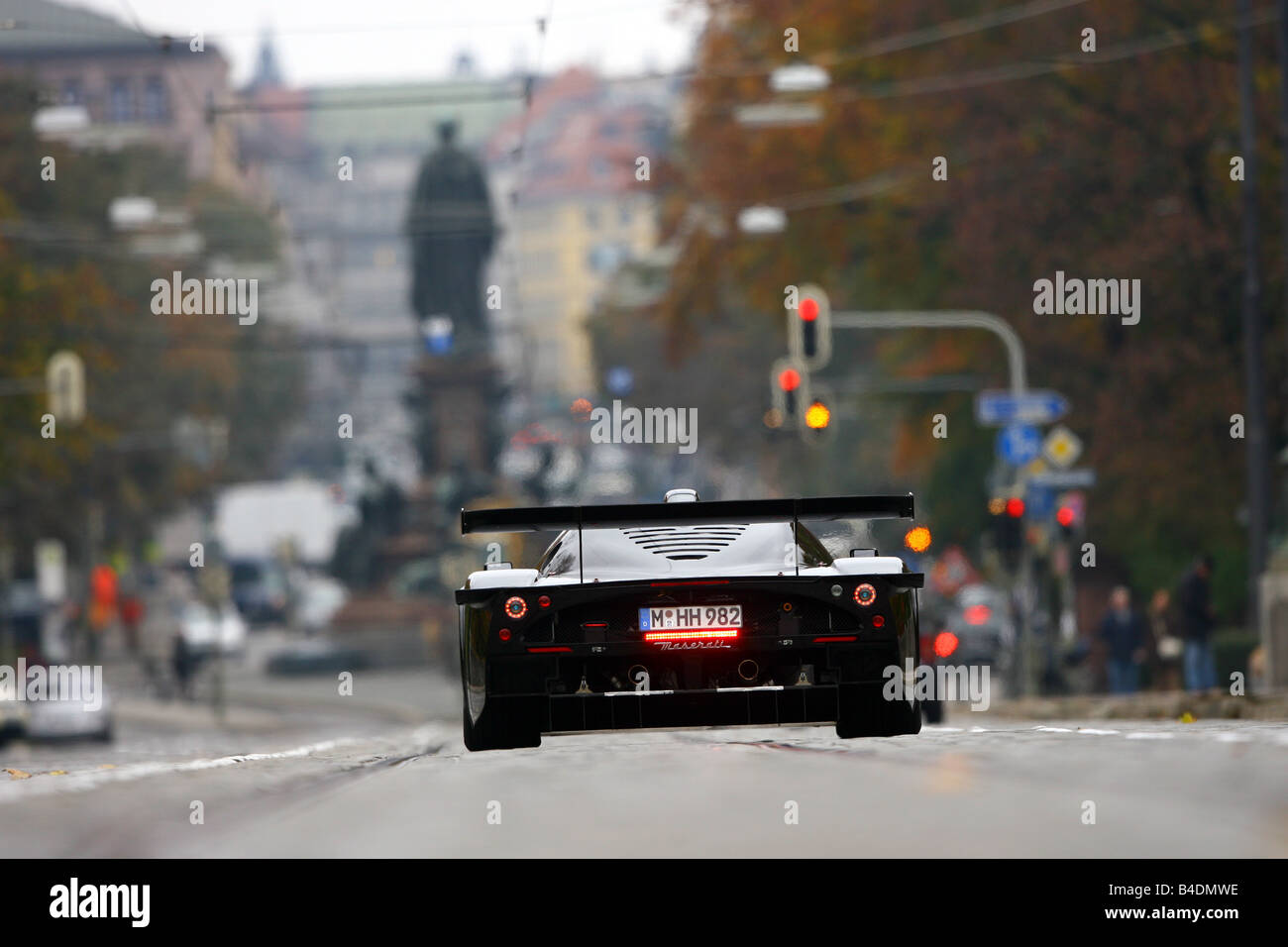 Maserati MC 12 Corsa, model year 2007-, black, driving, diagonal from the back, rear view, City - Stock Image