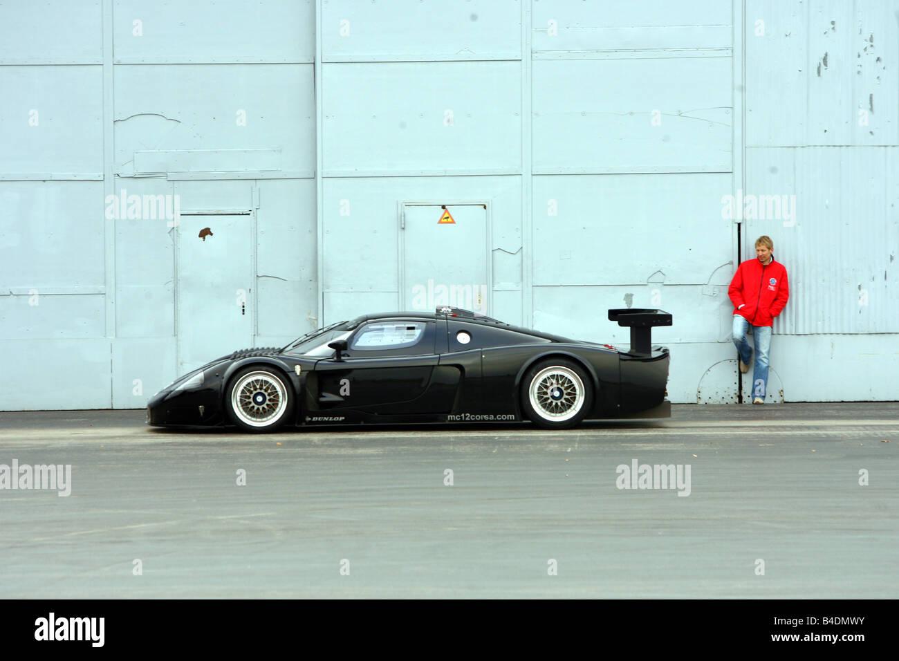 Maserati MC 12 Corsa, model year 2007-, black, standing, upholding, side view - Stock Image